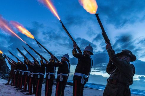 GALLIPOLI: Members of the Albert Battery perform a gun salute during the Anzac Day dawn service held by the Currumbin RSL on the Gold Coast in Currumbin, Australia. Photograph: Glenn Hunt/EPA