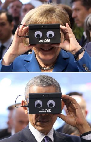 HI-TECH HANNOVER: US president Barack Obama and German chancellor Angela Merkel as they test virtual reality goggles when touring the Hannover Messe, the world's largest industrial technology trade fair. Photograph: Christian Charisius/DPA via AP
