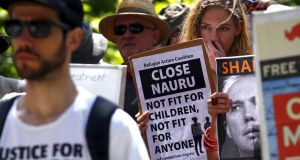 Protesters holds  placards during a rally in support of refugees in central Sydney, last year. Photograph: David Gray/Reuters