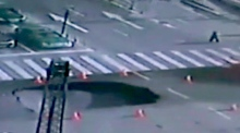 Sinkhole opens up in the middle of busy Chinese street