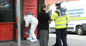 Gardaí at the scene of the shooting of Michael Barr at the Sunset House pub on Summerhill in Dublin where forensic tests were being carried out on Tuesday  morning. Photograph: Cyril Byrne/The Irish Times