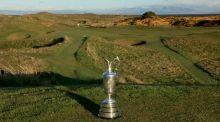 The Claret Jug in front of Royal Troon's Postage Stamp. Photograph: Getty