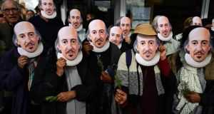 Members of the public prepare for a parade marking the 400 years since the death of William Shakespeare, in Stratford-upon-Avon.  Photograph: Leon Neal/AFP/Getty Images