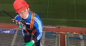 "Kate Whyte   abseiling  from the top of the Hogan Stand for charity. ½""When I couldn't bend my neck that triggered the alarm bells."""