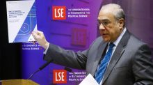 Jose Angel Gurria, secretary-general of the OECD, holds up his organisation's policy paper on the effects of Brexit during a speech at the London School of Economics on Wednesday. It became the latest international body to warn the UK that leaving the European Union would cause lasting damage to the economy. Photograph: Chris Ratcliffe/Bloomberg