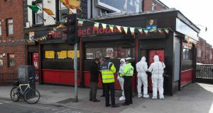 Gardai outside the Sunset House pub in Summerhill, in Dublin where a man was shot dead on  Monday. Photograph: Collins