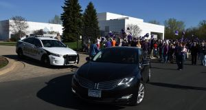 A car leaves Prince's Paisley Park compound  in Minneapolis, Minnesota, US, following the singer's death. Photograph: Mark Ralston/AFP/Getty Images