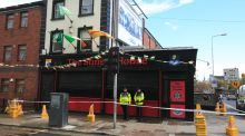 "Flowers at the Sunset House pub, Dublin. ""Interestingly another murder happened a few short hours later in Dublin's inner city within a short distance of a closed Fitzgibbon Street Garda station.""  Photo: Gareth Chaney"