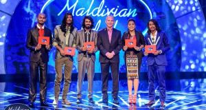 Andrew Healy pictured this week on the Bank of Maldives Twitter account, in the middle of a group of contestants in the Maldivian Idol competition