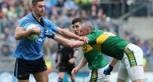 Dublin's James McCarthy in action against Kieran Donaghy of Kerry. Photo: Lorraine O'Sullivan/Inpho