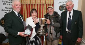 Mike Keady (Moycullen) is presented with the Connacht Cup by Kathleen Reynolds. Also pictured, from left: Eugene Nolan, Connacht Angling Council and Martin Kinneavey, Chairman, Connacht Angling Council. Photograph: Michael Donnelly