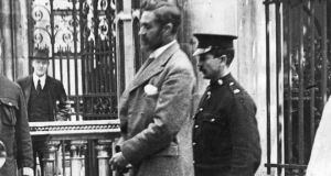 Roger Casement  is escorted to the gallows of Pentonville Prison, London.  Photograph: Getty