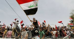 Followers of Iraqi Shia   cleric, politician and militia leader, Moqtada al-Sadr,  protesting  outside Baghdad's heavily fortified Green Zone last week. Photograph: Ahmed Saad/Reuters