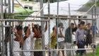 A March 2014 photograph made available this week, shows asylum seekers at the  Manus Island detention centre in Papua New Guinea. Photograph: Eoin Blackwell/EPA