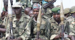 War and dictatorship: Government soldiers on patrol. Photographs: Dearbhla Glynn and (Mama Masika) Frontline Defenders