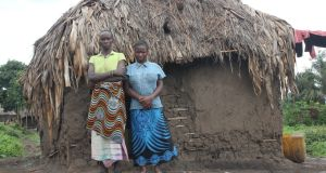 A mother and daughter in front of the hut where the mother was beaten and the daughter raped. Photographs: Dearbhla Glynn and (Mama Masika) Frontline Defenders