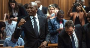 South Africa's main opposition party Democratic Alliance leader Mmusi Maimane celebrates  the Pretoria high court ruling that corruption charges against President Jacob Zuma could be reinstated. Photograph: Mujahid Safodien/AFP/Getty Images