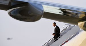 President Barack Obama walks down the steps of Air Force One at Andrews Air Force Base after returning from a foreign trip to Saudi Arabia, England and Germany. Photograph: AP/Susan Walsh