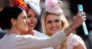 Racegoers pose for a selfie during Ladies' Day at the Punchestown Festival. Photograph: Brian Lawless/PA Wire