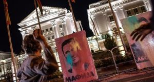 Protesters target images of former Macedonian prime minister Nikola Gruevski (left) and Macedonian president George Ivanov  with balloons filled with paint in front of government buildings. Photograph: Georgi Licovski/EPA