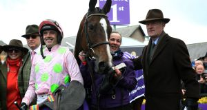 Jockey Ruby Walsh with trainer Willie Mullins (right) after winning the Betdaq Punchestown Champion Hurdle on  Vroum Vroum Mag during day four of Punchestown festival  yesterday. Photograph:   Brian Lawless/PA Wire