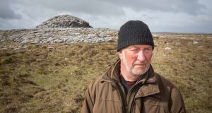 Dr Stefan Bergh, Department of Archeology NUI Galway, at the cairn on Turlough Hill in the Burren, Co Clare. Photograph: Eamon Ward
