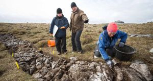 Dr Stefan Bergh, Department of Archeology NUI Galway (centre) with Dr Noel McCarthy, co-director, and Mary Howard, archeological volunteer, at their excavation on Turlough Hill in the Burren, Co Clare. Photograph: Eamon Ward