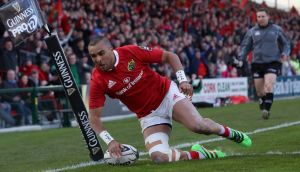 Munster's Simon Zebo scores a try during the Guinness Pro 12 game against Edinburgh. Photograph:   Billy Stickland/Inpho
