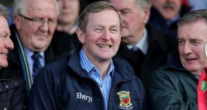 Acting Taoiseach Enda Kenny enjoys the action during the Eirgrid All-Ireland U21 Football Championship Final between Mayo and Cork at Cusack Park in Ennis. Photograph: Donall Farmer/Inpho