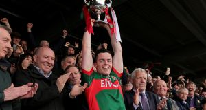 Mayo captain Stephen Coen lifts the All-Ireland U-21 Football Championship trophy after the victory over Cork at Cusack Park, Ennis. Photograph:   Donall Farmer/Inpho