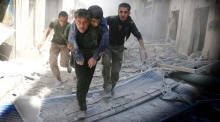 Death toll climbs in Syria as air strikes pound Aleppo