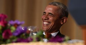 President Barack Obama laughs as he listens to Larry Wilmore, the guest host from Comedy Central, speak at the annual White House Correspondents' Association dinner. Photograph: AP