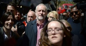 Labour leader Jeremy Corbyn at  a May Day rally in London on Sunday: he  announced an independent review and pledged to tighten party codes of conduct in a bid to put a lid on the row. Photograph:  Anthony Devlin/PA Wire