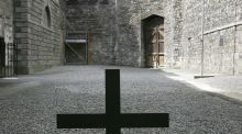 A cross marks the place where James Connolly was executed, sitting in a chair, in the stonebreakers yard at Kilmainham Gaol. photograph: frank miller