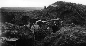 Soldiers in a trench outside a dugout at Verdun in November 1916. Photograph: Topical Press Agency/Getty Images