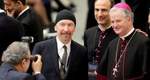 U2 guitarist The Edge, whose real name is David Evans, poses with Irish bishop Paul Tighe before listening to US vice-president Joe Biden speak at the Vatican. Photograph: Max Rossi/Reuters