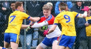 New York's Luke Loughlin  is closed down by   Roscommon's Niall McInerney (left) and Cathal Compton during Connacht SFC clash at Gaelic Park in the Bronx, New York on Sunday. Photograph: Ed Mulholland/Inpho