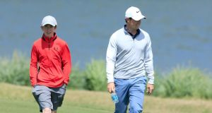 Rory McIlroy  pictured  with Tom McKibbin at the Dell Match Play in Austin back in March. The 13-year-old will play alongside McIlroy in the pro-am for the Irish Open later this month. Photograph:  David Cannon/Getty Images