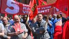 Some 200 employees of the Schuler Pressen GmbH gather for a warning strike rally in front of the entrance to the company's plant in Erfurt, Germany, on Monday. Photograph: EPA