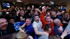 Leicester City fans celebrate after Chelsea equalised against Tottenham, handing their club the Premier League title. Photo: Eddie Keogh/Reuters