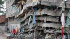 Locals walk next to a collapsed building in the Huruma estate of Mathare slum, Nairobi, Kenya, 1st May 2016. Photograph: Dai Kurokawa/EPA