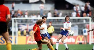 England's Ray Wilkins is challenged for the ball by Belgium's Walter Meeuws during their Group Two match. Photo: Bob Thomas/Getty Images