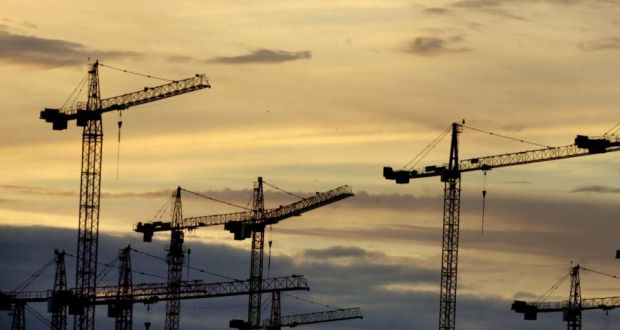 Construction cranes: becoming an increasingly common sight over Dublin. Photograph: Dara Mac Dónaill/The Irish Times