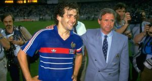 Michel Platini of France with coach Michel Hidalgo after victory in the 1984 European Championship Final against Spain at Parc des Princes in Paris. France won the match 2-0. Photo: David Cannon /Allsport