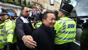 Leicester City Chairman Vichai Srivaddhanaprabha leaves the San Carlo Pizzeria in Leicester after his club won the Premier League. Photo: Joe Giddens/PA Wire