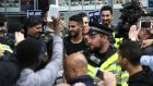 Riyad Mahrez is mobbed outside a restaurant in Leicester. Photograph: Afp