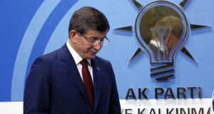Turkey's prime minister Ahmet Davutoglu leaves  a press conference  on Thursday. Photograph: Burhan Ozbilici/AP
