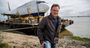 A decommissioned Boeing 767 has started a gruelling 36 hour journey by sea from Shannon Airport to Enniscrone, Co Sligo where it will find a new home as part of a glamping village being developed there by businessman David McGowan. Photograph: Alan Place/Fusionshooters