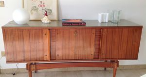 Elizabeth Francis's mid-century sideboard with a glass top, brass piano hinges and a fold-down centre