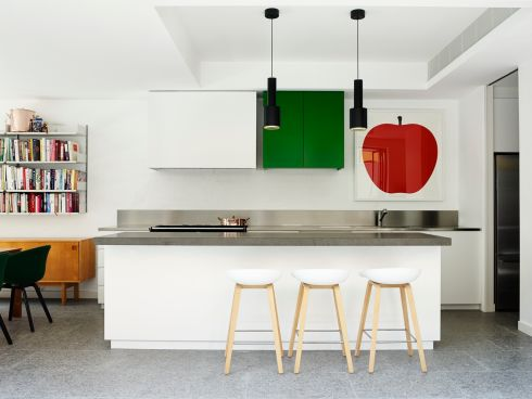 Australian interior designers Juliette Arent and Sarah-Jane Pyke of Arent & Pyke, in collaboration with architect Tom Ferguson, won design awards for this kitchen. This simple use of emerald green, a Dulux colour called Billiard Ball in Australia – the nearest shade here is Emerald Green – turns a boring all-white kitchen into something showstopping.  Photograph: Anson Smart </br> arentpyle.com, tfad.com.au idea-awards.com.au, australianinteriordesignawards.com